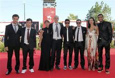 """<p>(L to R) Actors Yoav Donat, Michael Moshonov, director Samuel Maoz and his wife, actors Oshri Cohen, Zohar Strauss, Reymonde Amsallem and Dudu Tassa pose during the premiere of """"Lebanon"""" at the 66th Venice Film Festival September 8, 2009. REUTERS/Alessandro Bianchi</p>"""