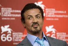 <p>U.S. actor Sylvester Stallone poses during a photocall before he is presented with the Jaeger-LeCoultre Glory to the Filmmaker Award during the 66th Venice Film Festival September 12, 2009. REUTERS/Alessandro Bianchi</p>