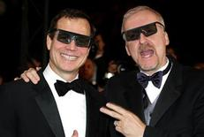 <p>US director James Cameron (R) and actor and narrator Bill Baxton (L) wear 3-D glasses during at the 56th International Film Festival in Cannes, May 17, 2003. REUTERS/Eric Gaillard</p>