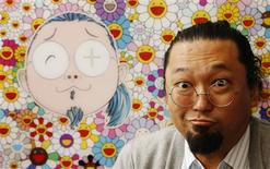 <p>Japanese artist Takashi Murakami poses with his artwork Kirsten Dunst & McG & Me at the launch of the Pop Life : Art in a Modern World exhibition at the Tate Modern in London September 29, 2009. REUTERS/Luke MacGregor</p>