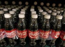 <p>Bottles of Coca-Cola soft drinks are seen on a grocery store shelf in Arlington, Virginia, August 17, 2009. REUTERS/Jim Young</p>