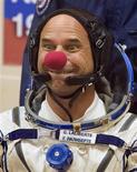 <p>Canadian billionaire Guy Laliberte jokes after putting on his space suit at Baikonur cosmodrome September 30, 2009. REUTERS/Shamil Zhumatov</p>