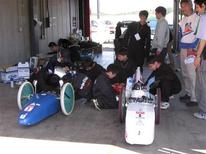 """<p>Teams of engineers and aspiring engineers participate in the annual Honda """"Eco-Run"""" competition in Motegi, north of Tokyo, October 11, 2009. In the event, contenders design vehicles powered by a four-stroke 50cc engine, driving them seven laps around a track for a total 16.8 km (10.4 miles) using as little fuel as possible. Apart from a few regulations on the vehicle's dimensions -- they must measure under 3.5 metres (12 ft) long and have at least three wheels, for instance -- the rules are simple: cover the designated distance in under 39 minutes and 20 seconds, equivalent to a minimum speed of 25 km (15.5 miles) an hour. The mileage is calculated based on the amount of petrol consumed. The record so far is a mind-boggling 3,435 km/litre (8,080 miles per gallon), set in 2001. Picture taken October 11, 2009. REUTERS/Chang-Ran Kim</p>"""