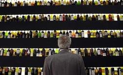 <p>A man looks at bottles of wine on display at the Vinitaly wine expo in Verona April 3, 2009. REUTERS/Alessandro Garofalo</p>
