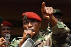 <p>Captain Moussa Dadis Camara of Guinea gestures during a meeting with political parties and local people at the military camp Alpha Yaya Diallo in Conakry December 27, 2008. REUTERS/Stringer</p>