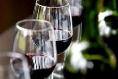 <p>Glasses and bottles of Chateau Belcier red wine (Saint Emilion label) are seen in a testing room in Saint Emilion, southwestern France, November 6, 2007. REUTERS/Regis Duvignau</p>