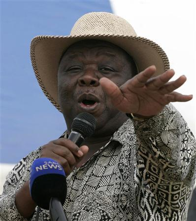 Zimbabwe's Prime Minister and Main opposition Movement For Democratic Change (MDC) leader Morgan Tsvangirai addresses party supporters at Chibuku stadium in Chitungwiza, 25km (15 miles) south of the capital Harare, November 8, 2009. Tsvangirai told the gathering that President Robert Mugabe's ZANU PF must treat his party MDC as a equal partner inorder to resolve the outstanding issues in the Global Political Agreement (GPA). REUTERS/Philimon Bulawayo