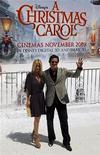 """<p>Актер Джим Кэрри со своей подругой Дженни макКарти рекламирует фильм """"Рождественская история"""" на кинофестивале в Каннах 18 мая 2009 года. Экранизация романа Чарльза Диккенса """"Рождественская песнь"""" - """"Рождественская история"""" режиссера Роберта Земекиса, созданная компанией Walt Disney Co's, занимает лидирующую позицию по кассовым сборам в Северной Америке, собрав $31 миллион, что оказалось ниже ожидавшихся результатов. REUTERS/Jean-Paul Pelissier</p>"""