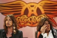 """<p>Aerosmith's Steven Tyler (L) and Joe Perry attend a press conference for the new video game """"Guitar Hero: Aerosmith"""" in New York, June 27, 2008. REUTERS/Lucas Jackson</p>"""