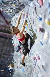 <p>Instructor Abby Nelson scales a 10,000-square-foot wall at Chelsea Piers Sports Center in New York City in an undated photo. REUTERS/Scott McDermott/Handout</p>