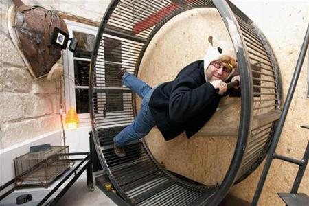 French architect Frederic Tabary poses inside the ''Hamster's Villa'', imagined and conceived by Tabary together with architect Yann Falquerho, during an interview with Reuters in Nantes, western France, November 8, 2009. REUTERS/Stephane Mahe
