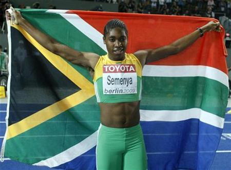 Caster Semenya of South Africa celebrates after winning the women's 800 metres final during the world athletics championships at the Olympic stadium in Berlin August 19, 2009. REUTERS/Dominic Ebenbichler