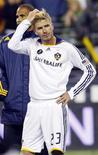 <p>David Beckham vê comemoração depois de perder a final para o Real Salt Lake, em Seattle. David Beckham possui uma opção para ser dono de um 20o time na Major League Soccer, afirmou o comissário da liga norte-americana de futebol no domingo.22/11/2009.REUTERS/Robert Sorbo</p>