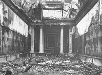"""<p>A handout photograph released in London November 24, 2009, shows the damage sustained by Bridgewater House in London during World War Two German air raids in 1941. Paul Delaroche's """"Charles I Insulted by Cromwell's Soldiers"""", was hanging in the dining room at the time and sustained extensive shrapnel damage. REUTERS/The Times/Handout</p>"""
