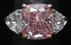 """<p>A ring set with """"The Vivid Pink"""", a 5.00 carat cushion-shaped Fancy Vivid Pink Potentially Flawless diamond, the largest such diamond to ever be offered for sale, is displayed at a preview by auction house Christie's, in Hong Kong September 21, 2009. REUTERS/Bobby Yip</p>"""