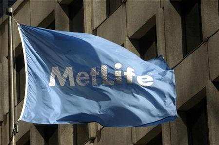 A MetLife flag is pictured outside the MetLife building in New York, January 31, 2005. REUTERS/Chip East