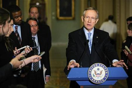 Senate Majority Leader Harry Reid talks to reporters about healthcare legislation after the senate Democrats' weekly policy lunch on Capitol Hill, December 8, 2009. REUTERS/Jonathan Ernst