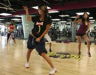 <p>People participate in a Cardio Go Go class at Crunch Fitness in Los Angeles in this undated handout. REUTERS/Crunch Fitness/Handout</p>