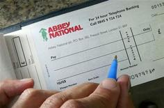 <p>An Abbey National cheque book is pictured in London July 26, 2004. BANKG REUTERS/Toby Melville</p>