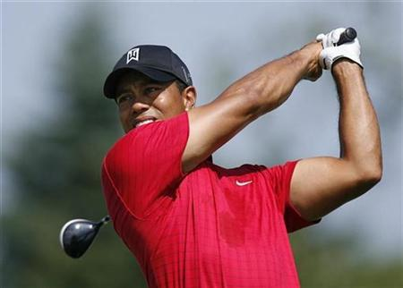 Tiger Woods of the U.S. hits off the fifth tee during the final round of The Barclays golf tournament at Liberty National Golf Course in Jersey City, New Jersey, August 30, 2009. REUTERS/Lucas Jackson