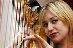 <p>Harpist Jemima Phillips who will play at Prince Charles' wedding reception poses for photographs in western England. REUTERS/Barry Batchelor/Pool</p>