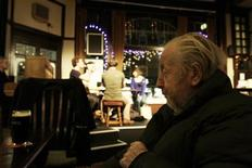 <p>A customer sits at a table whilst a production of La Boheme takes place onstage at the Cock Tavern Theatre in north London, in this December 10, 2009 file photo. REUTERS/Simon Newman</p>