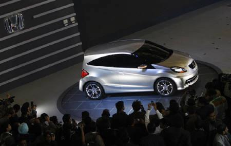Photographers Take Pictures Of Hondas New Small Concept Car At Indias Auto Expo In Delhi January 5 2010 Japans Honda Motor Co Will Price Its