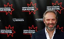 <p>Film director Sam Mendes poses for photographers before attending the screening of his new film 'Away We Go' at the opening night of the Edinburgh International Film Festival, Scotland June 17, 2009. REUTERS/David Moir</p>