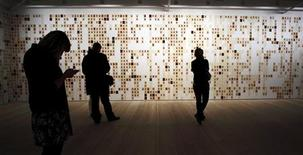 <p>Visitors view hundreds of drawings of U.S. servicemen and women who have died in Iraq and Afghanistan by artist Emily Prince at the Saatchi Gallery in London January 7, 2010. REUTERS/Kevin Coombs</p>