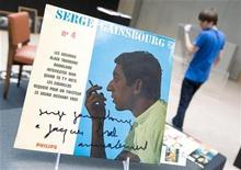 <p>An record autographed by late French singer Serge Gainsbourg, to late Belgium singer Jacques Brel, is displayed during an exhibition with personal effects at Sotheby's auction house in Paris October 3, 2008. REUTERS/Gonzalo Fuentes</p>