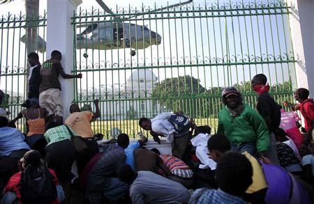 U.S. troops deploy as Haiti aid operation picks up