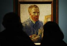 <p>Visitors look at Vincent Van Gogh's Self Portrait as an Artist 1888, during the launch of The Real Van Gogh: The Artist and His Letters exhibition at the Royal Academy of Arts in London January 19, 2010. REUTERS/Luke MacGregor</p>