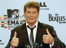 <p>U.S. actor and singer David Hasselhoff poses on the red carpet before the MTV Europe Awards ceremony in Berlin November 5, 2009. REUTERS/Fabrizio Bensch</p>