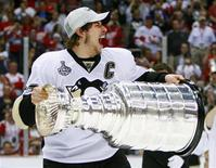 <p>Pittsburgh Penguins captain Sidney Crosby celebrates while hoisting the Stanley Cup, June 12, 2009. No athletes competing at the Vancouver Winter Games will be under more pressure than Canada's men's ice hockey team and no player under greater scrutiny than Sidney Crosby. For many residents of the hockey mad Great White North the Olympics will not be success unless it includes the men's hockey gold medal. REUTERS/Shaun Best</p>