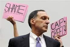 <p>Protestors hold signs behind Richard Fuld, Chairman and Chief Executive of Lehman Brothers Holdings, as he takes his seat to testify at a House Oversight and Government Reform Committee hearing on the causes and effects of the Lehman Brothers bankruptcy, on Capitol Hill in Washington, in this October 6, 2008 file photo. REUTERS/Jonathan Ernst</p>