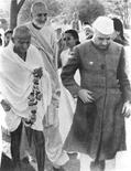 "<p>Badshah Khan (C), Mahatma Gandhi (L) and India's first Prime Minister Jawaharlal Nehru are seen in this undated handout photograph released on February 3, 2010. Badshah Khan was so close to Mahatma Gandhi they shared reading glasses and his biographer joked about their shared vision, but the great Pashtun warrior of the non-violent struggle has been almost forgotten by his people. Now Canadian filmmaker Teri McLuhan hopes to drag the man dubbed ""Frontier Gandhi"", and his role in winning independence from British rule, back into the limelight. REUTERS/Peace on Earth Productions/Teri C. McLuhan</p>"