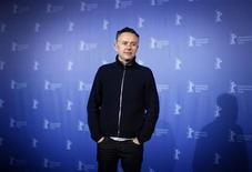 """<p>Film director Michael Winterbottom poses during a photocall to promote the movie """"The Killer inside me"""" at the Berlinale International Film Festival in Berlin, February 19, 2010. REUTERS/Christian Charisius</p>"""