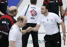 <p>Canada's skip Kevin Martin (L) shakes hands with Britain's skip David Murdoch (R) after Canada defeated Britain during their men's round robin curling game at the Vancouver 2010 Winter Olympics February 20, 2010. Also pictured is Britain's Ewan MacDonald. REUTERS/Lyle Stafford</p>