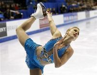 <p>Canada's Joannie Rochette performs during the Senior Women Free Program at the 2010 Canadian Figure Skating Championships in London, Ontario, January 16, 2010. REUTERS/Mark Blinch</p>