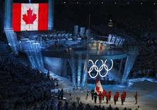 <p>16-year-old Canadian musical prodigy Nikki Yanofsky sings the Canadian national anthem as the Canadian flag is hoisted during the opening ceremony of the Vancouver 2010 Winter Olympics, February 12, 2010. REUTERS/Gary Hershorn</p>