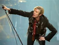 """<p>David Bowie performs his North American debut of """"A Reality Tour"""" in Montreal, December 13, 2003. REUTERS/Shaun Best</p>"""