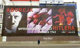 <p>A pedestrian passes by an anti-abortion poster showing a picture of Adolf Hitler juxtaposed with a foetus from an abortion, in the center of Poznan March 3, 2010. REUTERS/Marek Lapis/FORUM</p>