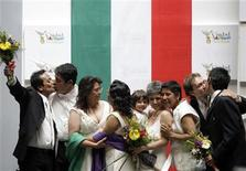 <p>Four same-sex couples celebrate after getting married at the town hall in Mexico City in this March 11, 2010 file photo. REUTERS/Daniel Aguilar</p>