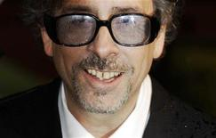 """<p>Director Tim Burton poses for photographers as he arrives at the Royal World premiere of """"Alice In Wonderland"""" at Leicester Square in London February 25, 2010. REUTERS/Luke MacGregor</p>"""