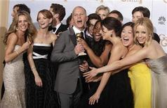 """<p>""""Glee"""" creator Ryan Murphy (C) and the cast celebrate backstage with their award after winning for best television series-comedy or musical the 67th annual Golden Globe Awards in Beverly Hills, California January 17, 2010. REUTERS/Lucy Nicholson</p>"""
