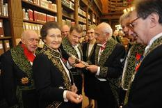 <p>French politician Simone Veil (2nd L), dressed in the French Academician's uniform of a black jacket embroidered in green laurel leaves, speaks with Academicians in the library of the Institut de France before a ceremony in Paris March 18, 2010. REUTERS/Philippe Wojazer</p>