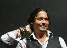 """<p>Cast member Johnny Depp stands on stage during a panel discussion for the movie """"Alice in Wonderland"""" during the 40th annual Comic Con Convention in San Diego July 23, 2009. REUTERS/Mario Anzuoni</p>"""