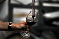<p>A worker tests a red wine inside the Montgras vineyards at Colchagua valley, south of Santiago March 25, 2010. REUTERS/Marco Fredes</p>