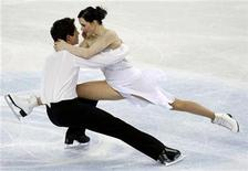 <p>Tessa Virtue (R) and Scott Moir of Canada perform during the ice dance free dance event at the World Figure Skating Championships in Turin March 26, 2010. REUTERS/Giampiero Sposito</p>