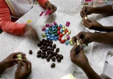Employees at ''Patisserie Abidjanaise'' wrap chocolate Easter eggs in Abidjan, March 20, 2008. REUTERS/Thierry Gouegnon